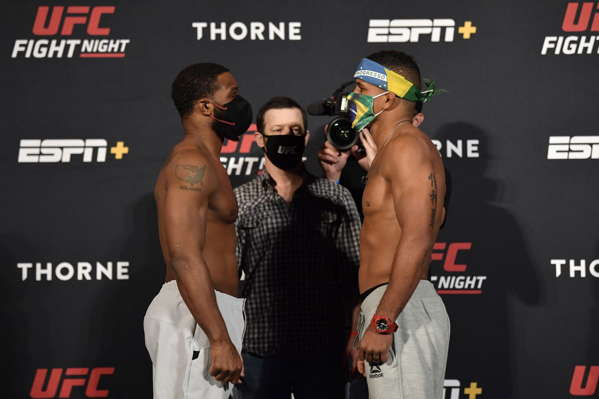 Opponents Tyron Woodley and Gilbert Burns of Brazil face off during the UFC weigh-in at UFC APEX on May 29, 2020 in Las Vegas, Nevada.