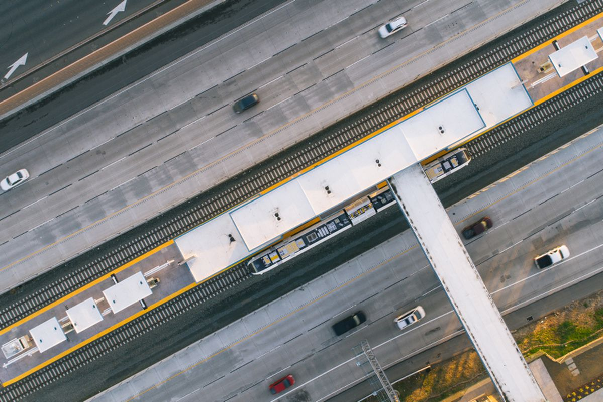 An aerial photo of a BART train at Antioch Station.