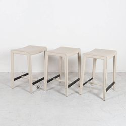 """<strong>Crate & Barrel</strong> Ivory Leather Stools, <a href=""""https://www.moveloot.com/shop/chairs/stools/5087-ivory-leather-stools"""">$280</a> (was $400); all photos via Move Loot"""