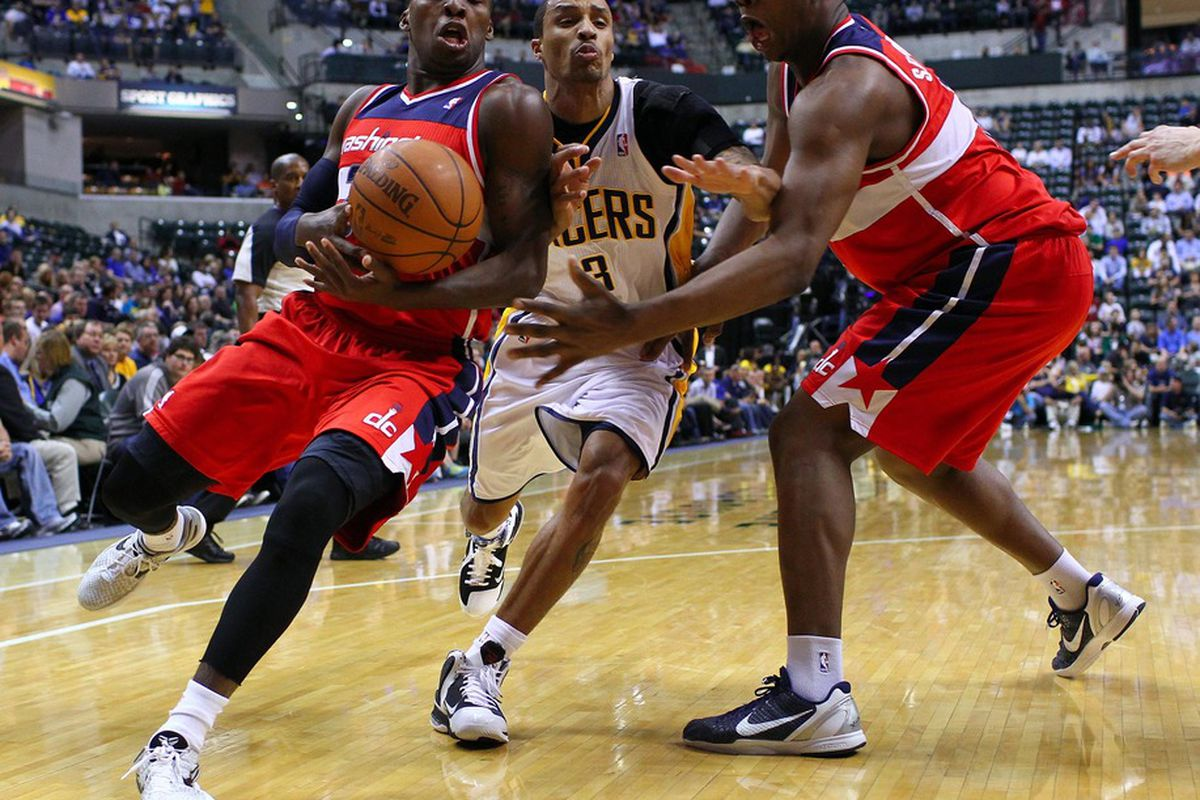 March 29, 2012; Indianapolis, IN, USA; Washington Wizards guard Shelvin Mack (22) tries to maintain control of the ball as Indiana Pacers shooting guard George Hill (3) defends at Bankers Life Fieldhouse. Mandatory credit: Michael Hickey-US PRESSWIRE