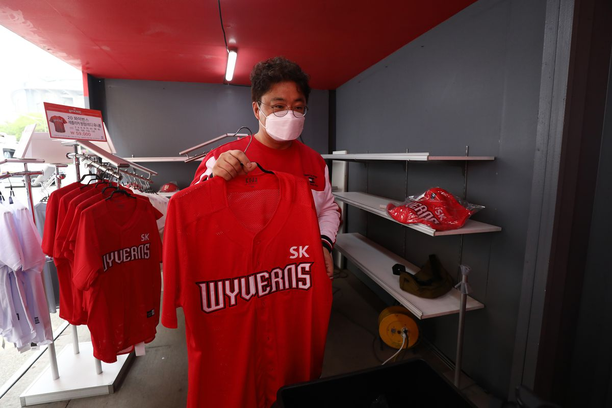 SK Wyverns fans buy their team's merchandise before the Korean Baseball Organization (KBO) League opening game between SK Wyverns and Hanwha Eagles at the empty SK Happy Dream Ballpark on May 05, 2020 in Incheon, South Korea.