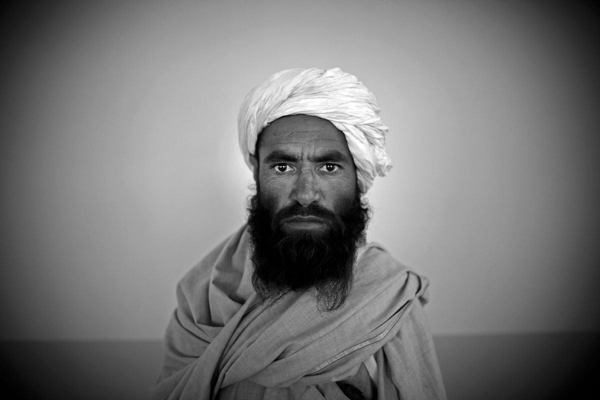 Surrendering Taliban militants are presented to the media on November 4, 2010 in Herat, Afghanistan.