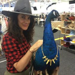 <strong>4:30pm</strong> More hats, peacocks and more gold at the Mega Mega Projects booth.