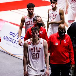 Utah Utes forward Mikael Jantunen (20) and teammates leave the court after their loss to the Oregon Ducks at the Huntsman Center in Salt Lake City on Saturday, Jan. 9, 2021.