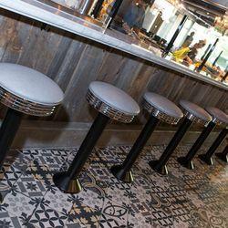 Bar stools at Culinary Dropout. Photo by Erik Kabik