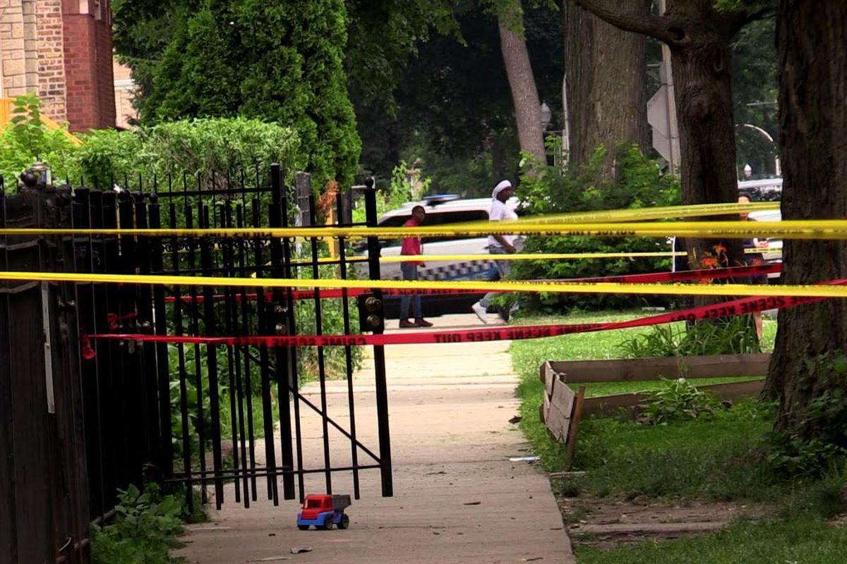 Police tape off the scene of a shooting