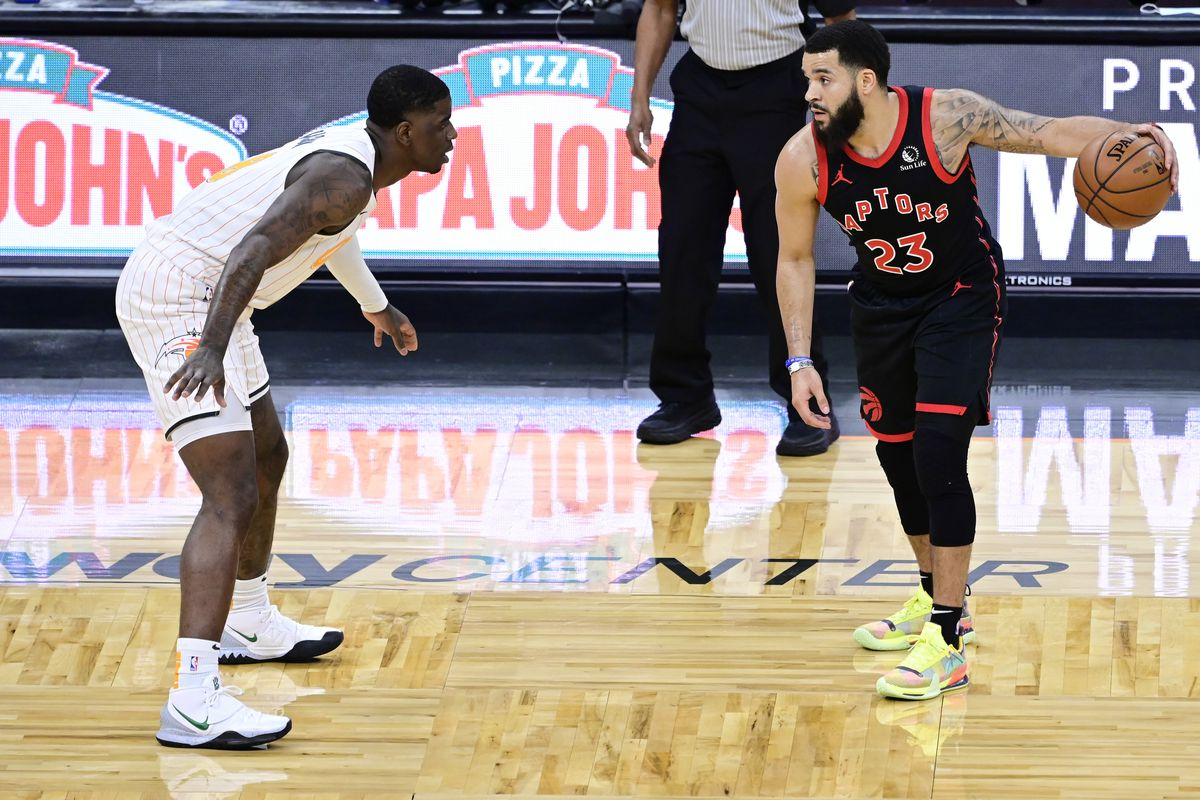 Fred VanVleet of the Toronto Raptors dribbles against Dwayne Bacon of the Orlando Magic during the first quarter at Amway Center on February 02, 2021 in Orlando, Florida.