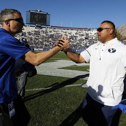 Brigham Young Cougars head coach Kalani Sitake, right, and San Jose State Spartans head coach Brent Brennan meet following NCAA football in Provo on Saturday, Oct. 28, 2017.