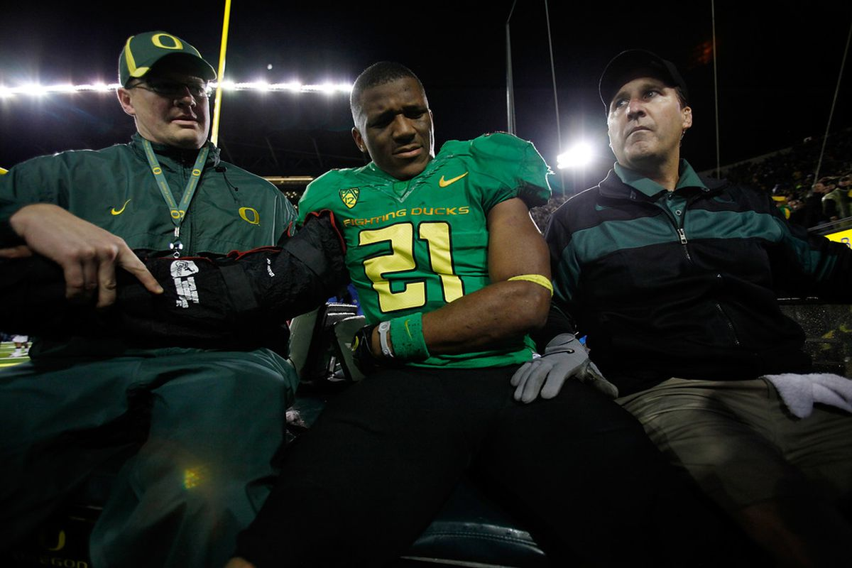 EUGENE, OR - OCTOBER 06:  LaMichael James #21 of the Oregon Ducks is carted off after injuring his arm against  the California Golden Bears on October 6, 2011 at the Autzen Stadium in Eugene, Oregon.  (Photo by Jonathan Ferrey/Getty Images)