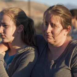 Beth Brown holds her daughter, Kelli Brown, during a rally asking Utah Gov. Gary Herbert to shut down Stericycle's medical waste incinerator in North Salt Lake on Thursday, Sept. 25, 2014.