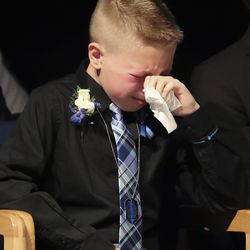 Preston Ricks, son of Herriman police K-9 Hondo's handler, Sgt. Ben Ricks, mourns during memorial services for the 7-year-old Belgian Malinois at Herriman High School in Herriman on Saturday, Feb. 29, 2020. Hondo was shot and killed in the line of duty on Feb. 13 while trying to apprehend a wanted violent fugitive who was also shot and killed after officers say he displayed a gun.