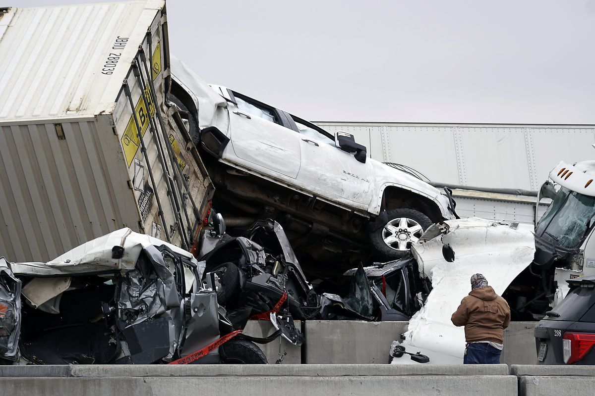 Vehicles are piled up after a fatal crash on Interstate 35 near Fort Worth, Texas on Thursday, Feb. 11, 2021.