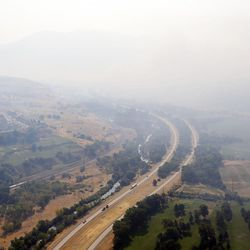 Smoke covers a portion of I-84 west of Weber Canyon due to a wildfire on Tuesday, Sept. 5, 2017.