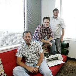 Executive vice president of sales Brad Brusa, chief marketing officer Matt Wilburn and CEO Jim Thornton pose with a Cricut machine at their Provo Craft corporate office in South Jordan Friday, July 16, 2010.