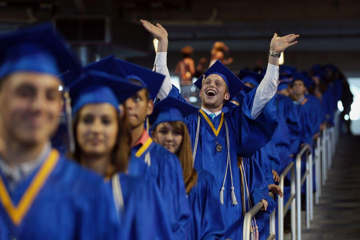 Graduates arrive at a high school graduation ceremony in Florida in 2012.