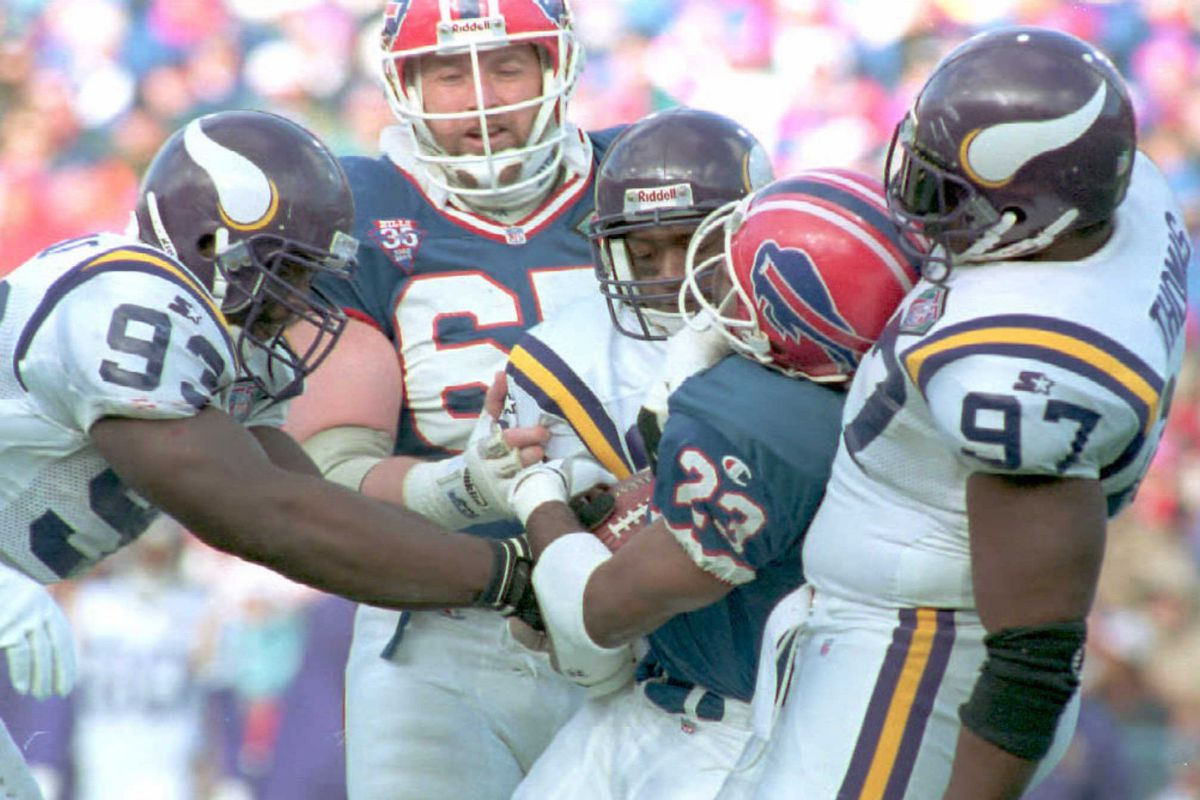 Buffalo Bills Kenneth Davis(23) gets wrapped up by