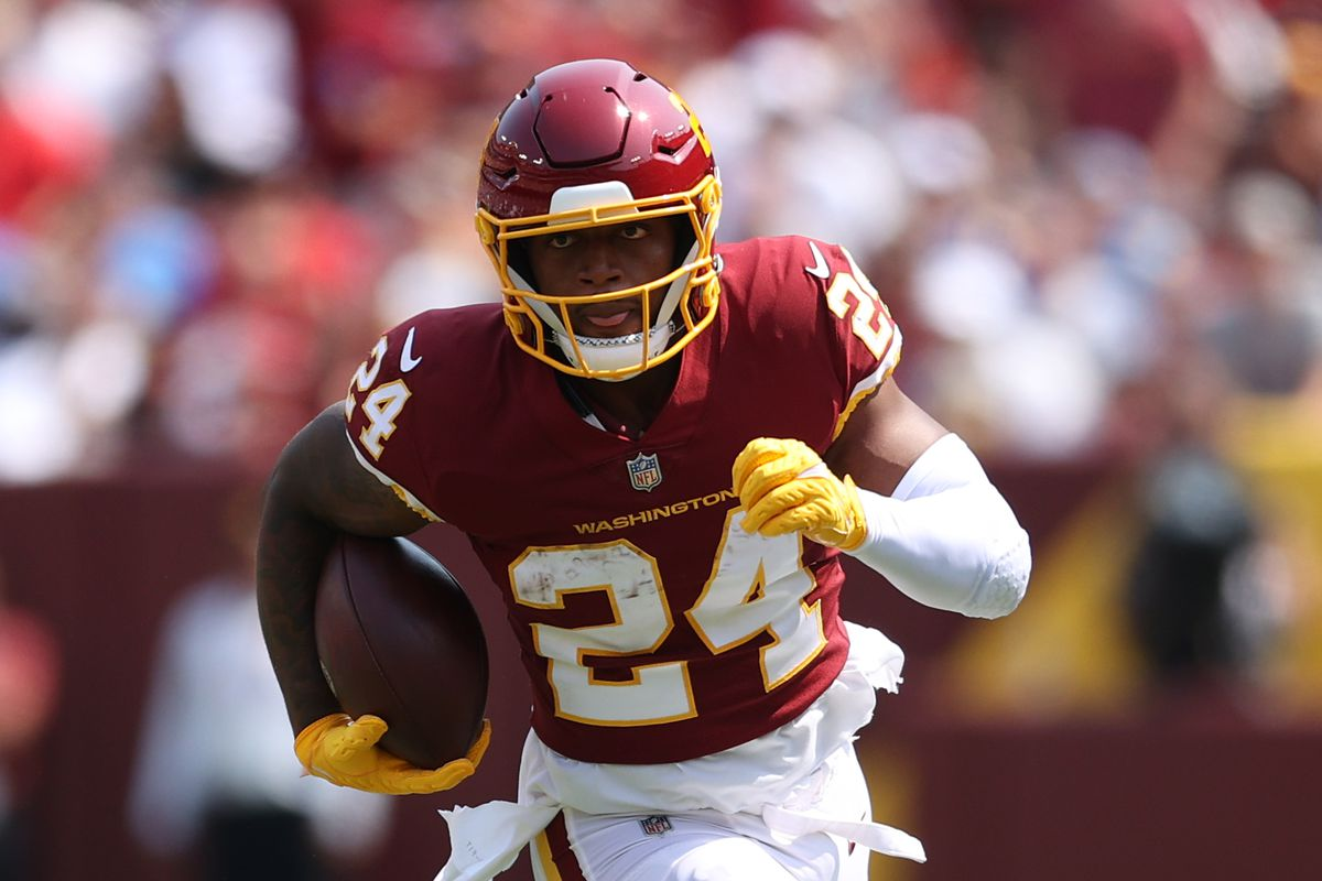 Antonio Gibson #24 of the Washington Football Team carries the ball during the game against the Los Angeles Chargers at FedExField on September 12, 2021 in Landover, Maryland.