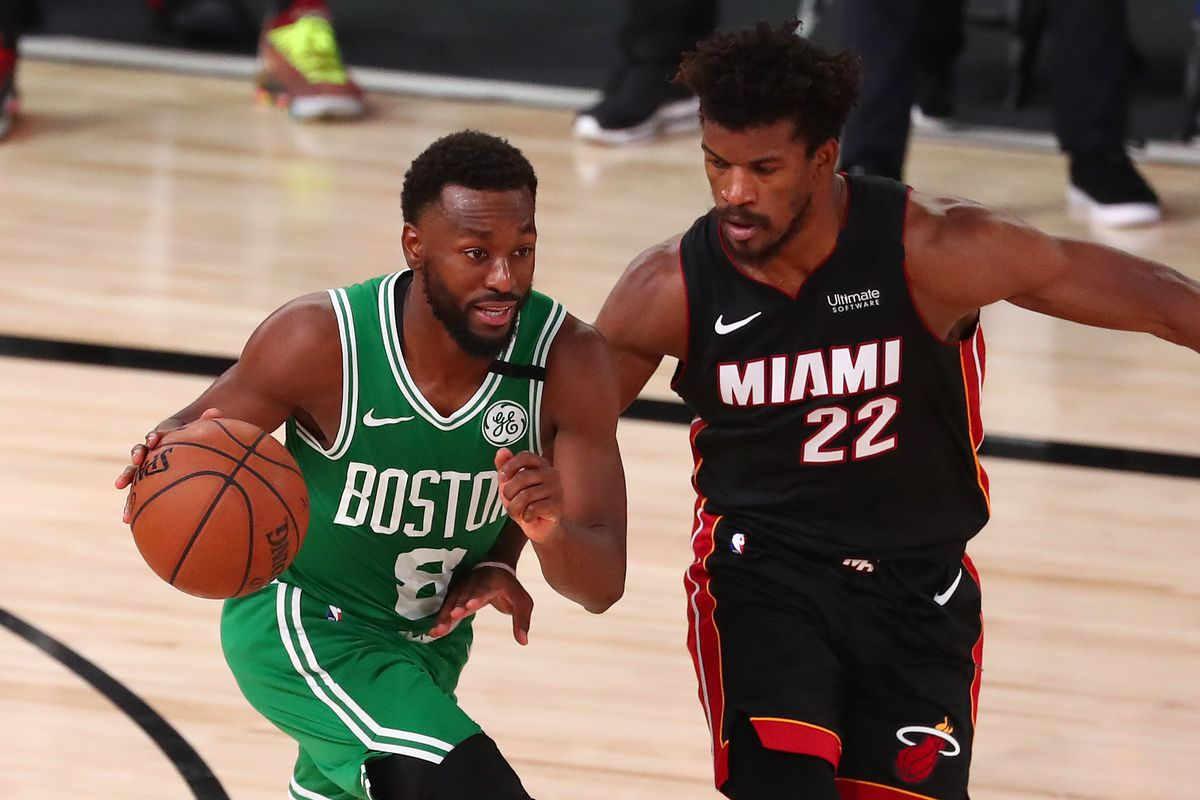 Boston Celtics guard Kemba Walker drives against Miami Heat forward Jimmy Butler during the second half of game four of the Eastern Conference Finals of the 2020 NBA Playoffs at AdventHealth Arena.