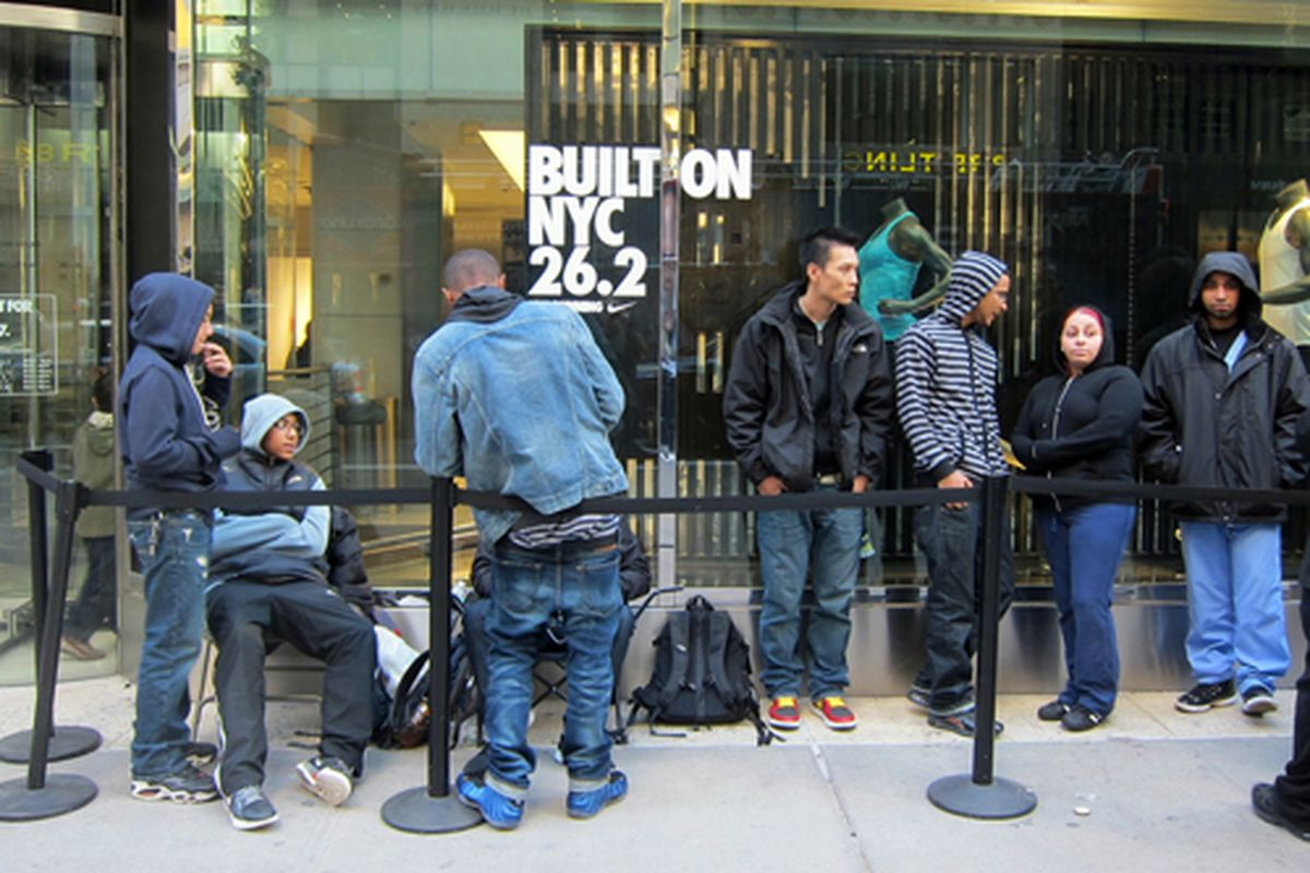 """On line for the new Air Jordans. Image via <a href=""""http://www.flickr.com/photos/62159569@N08/6319788596/in/pool-312691@N20/"""">Scoboco</a>/Racked Flickr Pool. Want to contribute? Join <a href=""""http://www.flickr.com/groups/rackedny/pool/with/631978859"""