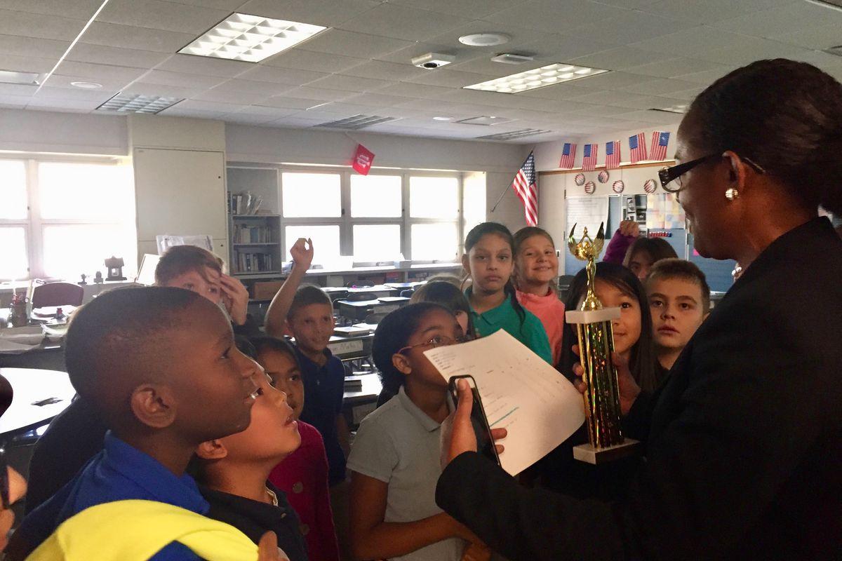 Principal Star Hardimon, celebrates math progress with fourth-graders at Douglas MacArthur Elementary School in Perry Township.