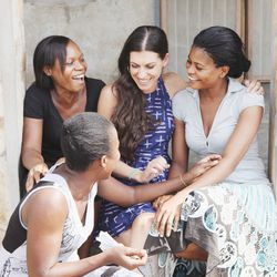 """<i>Tina Tangalakis with seamstresses in Ghana.</i></br></br> <b>You have extensive experience in humanitarian work in Africa. Did you ever have a particular moment that inspired you to create Della?</b></br> """"Yes, I absolutely had an 'ah-ha' moment. Ear"""