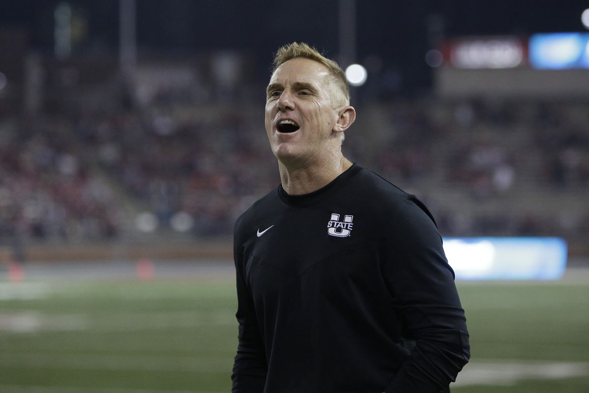 Utah State head coach Blake Anderson speaks to an official during the second half of an NCAA college football game.