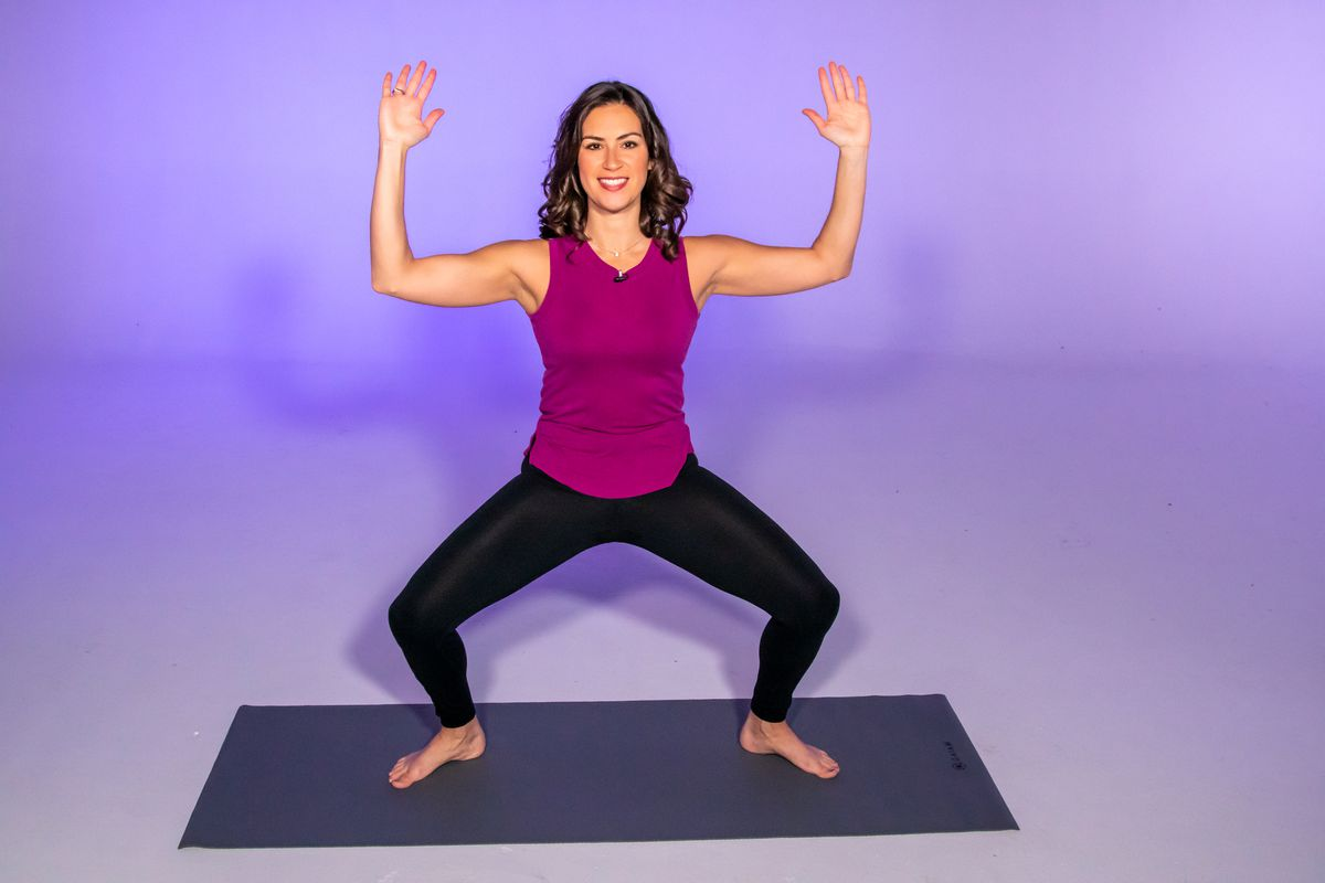 Stephanie Mansour demonstrates a horse or goddess pose.