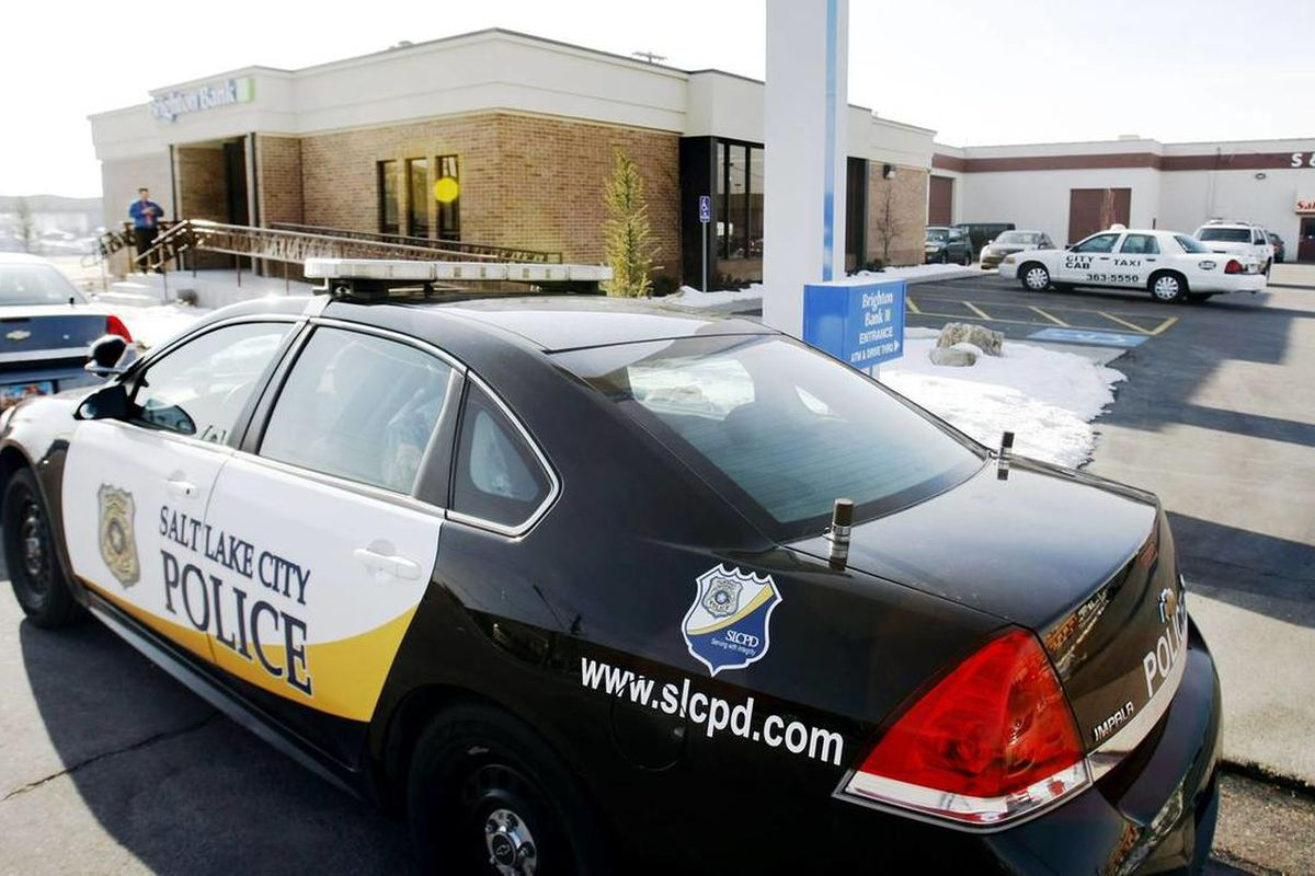 Salt Lake City Police Officers investigate a robbery Monday, Dec. 30, 2013 at Brighton Bank at 1402 south 300 west.