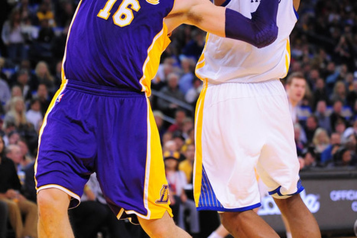 March 27, 2012; Oakland, CA, USA; Los Angeles Lakers power forward Pau Gasol (16) is fouled by Golden State Warriors forward Jeremy Tyler (right) during the first quarter at ORACLE Arena. Mandatory Credit: Kyle Terada-US PRESSWIRE