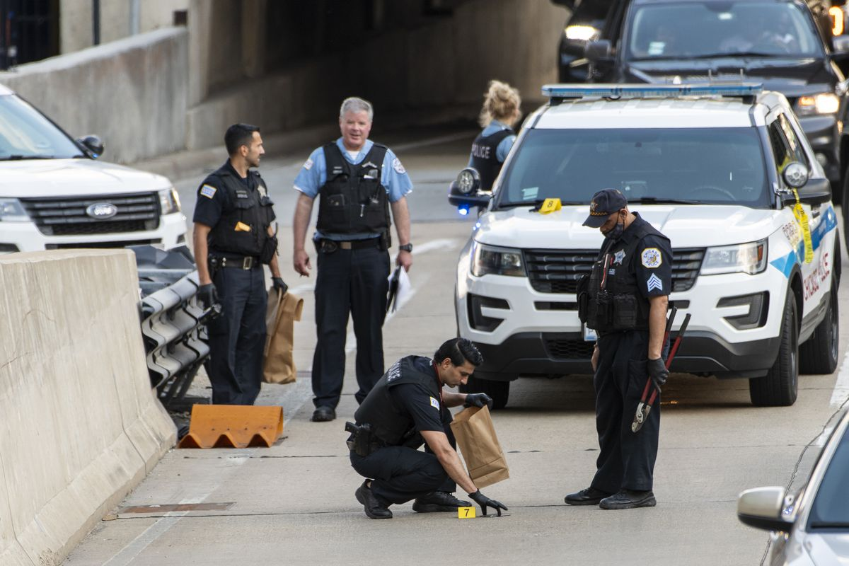 Chicago police mark potential evidence while investigating the fatal stabbing of a 31-year-old woman Saturday in the Loop's 400 block of South Wacker Drive.