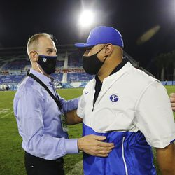 Brigham Young Cougars head coach Kalani Sitake celebrates the win over the UCF Knights with athletic director Tom Holmoe the Boca Raton Bowl in Boca Raton, Fla., on Tuesday, Dec. 22, 2020. BYU won 49-23.