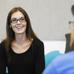 Salt Lake attorney Nicole Lowe talks to Gabe, a homeless youth, at Volunteers of America's Youth Resource Center in Salt Lake City on Thursday, Sept. 15, 2016.