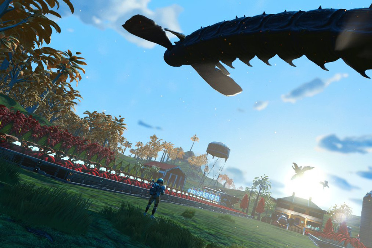 No Man's Sky - a giant sandworm jumps through the sky, above a player's base.
