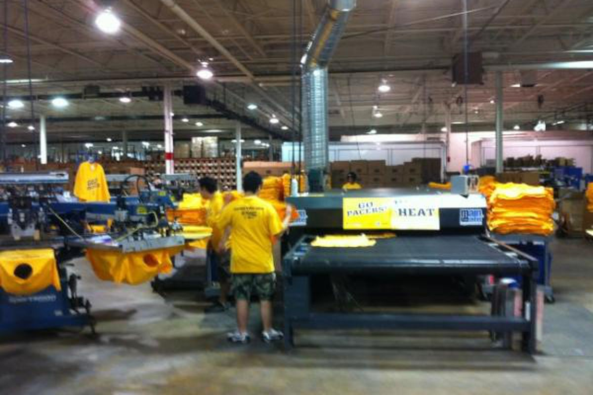 """MainGate cranking out """"Gold Swagger"""" shirts."""