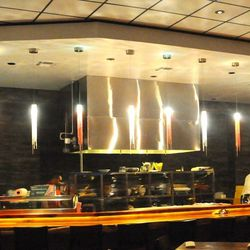 The sushi counter is designed to be a stage for Kinjo