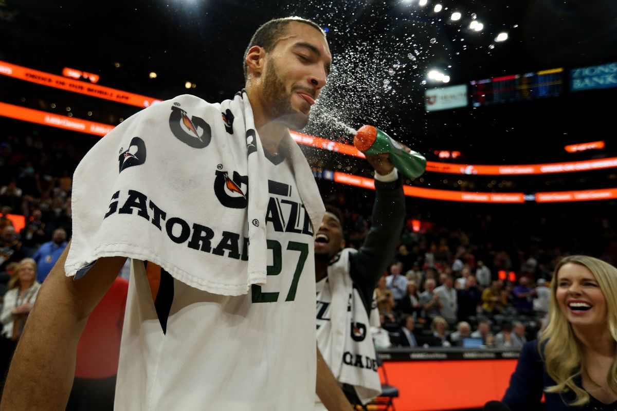 Utah Jazz center Rudy Gobert (27) gets sprayed with water by Donovan Mitchell after winning the game against Atlanta at Vivint Smart Home Arena in Salt Lake City on Friday, Feb.1, 2019.