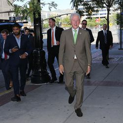 Former President Bill Clinton walks toward supporters after a roundtable meeting with business leaders at the One Utah Center in Salt Lake City on Thursday, Aug. 11, 2016.