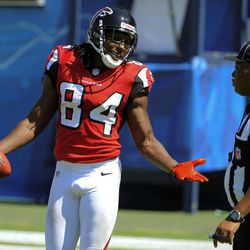 Atlanta Falcons wide receiver Roddy White, left, argues with official Derra Ramsey during the first half of an NFL football game against the San Diego Chargers in San Diego, Sunday, Sept. 23, 2012.