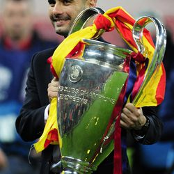 FILE - In this May 28, 2011 file picture Barcelona's coach Pep Guardiola holds the trophy after winning the Champions League final soccer match against Manchester United at Wembley Stadium, London. Pep Guardiola will not continue as Barcelona's coach after this season, according to Spanish news reports. Guardiola, whose contract expires at the end of the season, is scheduled to announce his decision on Friday April 27, 2012, in a news conference at 1330 local time (1130 GMT) with club president Sandro Rosell and sports director Andoni Zubizarreta.