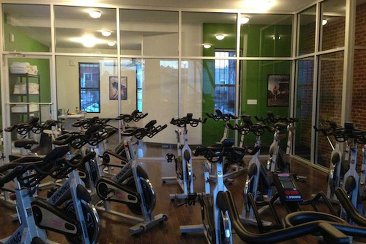 "Photo via <a href=""http://www.wellandgoodnyc.com/2014/01/26/astoria-gets-its-first-boutique-cycling-studio/"">Well + Good</a>"