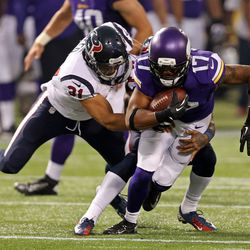 Aug 9, 2013; Minneapolis, MN, USA; Minnesota Vikings wide receiver Jarius Wright (17) gets tackled by Houston Texans defensive back Shiloh Keo (31) in the second quarter at the Metrodome.