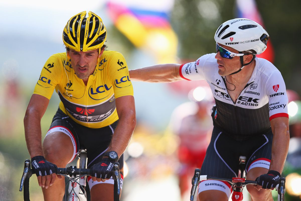 Fabian Cancellara is consoled by team mate Markel Irizar on the Mur du Huy after crashing today.