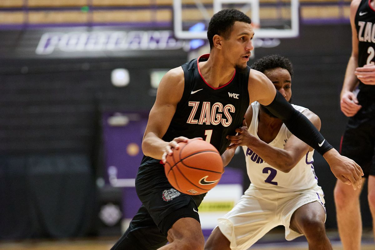 Gonzaga Bulldogs guard Jalen Suggs dribbles past Portland Pilots guard Ahmed Ali during the second half at Chiles Center.