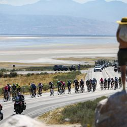 A spectator watches as the peloton passes by during Stage 3 of the Tour of Utah on Antelope Island on Thursday, Aug. 15, 2019.