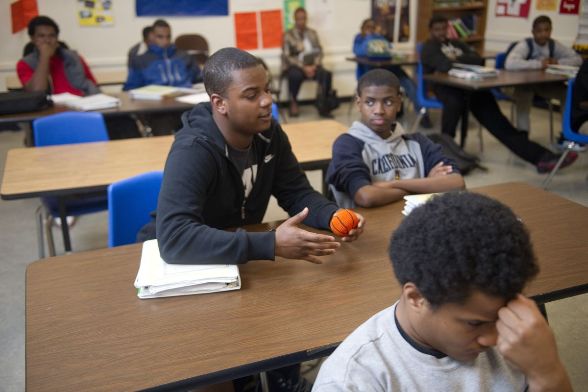 Oakland High School 10th grader, Barry Williams, answers a question from instructor Tiago Robinson during the Manhood Development Program, which is part of the district's African-American Male Achievement initiative. (Photo by Ann Hermes/The Christian Science Monitor via Getty Images)