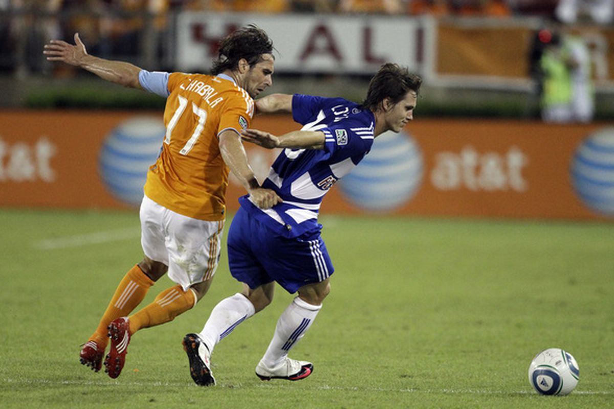 HOUSTON - MAY 05:  Zach Loyd #19 of FC Dallas is harassed by Mike Chabala #17 of the Houston Dynamo at Robertson Stadium on May 5, 2010 in Houston, Texas.  (Photo by Bob Levey/Getty Images)