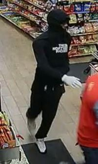 Surveillance photo of one of two suspects who robbed a Glendale Heights gas station at gunpoint.   Glendale Heights police