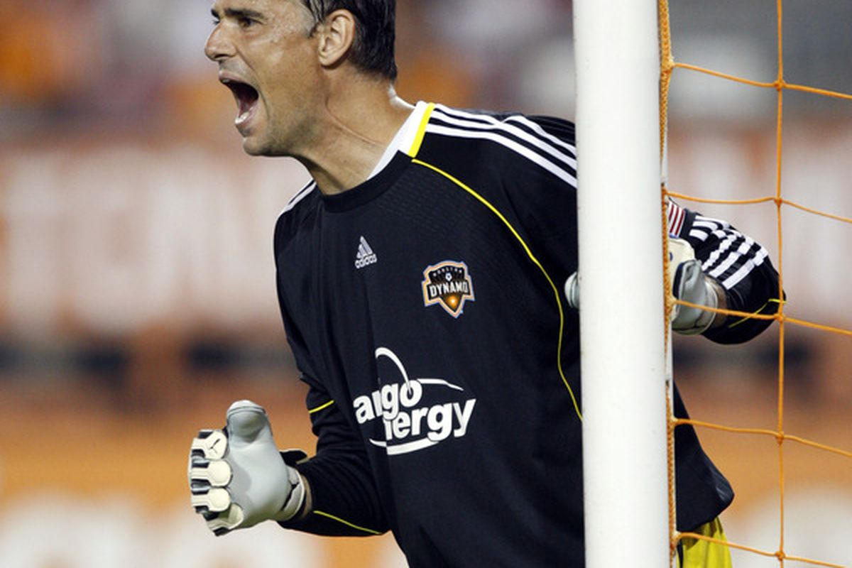 HOUSTON - SEPTEMBER 18:  Goalkeeper Pat Onstad #18 of the Houston Dynamo calls out instructions to his teammates as Toronto FC lines up for a free kick at Robertso Stadium  on September 18 2010 in Houston Texas.  (Photo by Bob Levey/Getty Images)