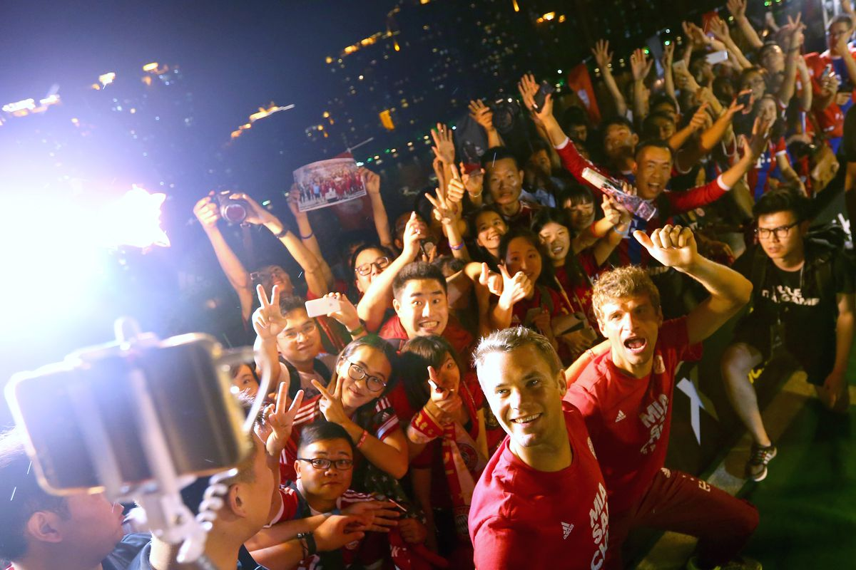 FC Bayern Audi China Summer Tour 2015 - Day 6 GUANGZHOU, CHINA - JULY 22: Manuel Neuer of FC Bayern Muenchen and his team mate Thomas Mueller (R) attends a fun football match at adidas marketing event on a cruise boat of the Guangzhou Pearl River at Dashatou Wharf on day 6 of the FC Bayern Audi China Summer Pre-Season Tour on July 22, 2015 in Guangzhou, China.