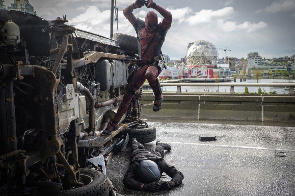 "Ryan Reynolds pounces on an adversary in ""Deadpool."" | Marvel/Twentieth Century Fox"